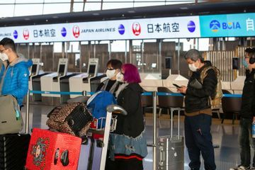 Japan urges citizens not to travel to China because of virus