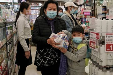 China reports 304 virus deaths, fires officials for poor job