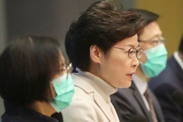 Hospitals cut services as worried Hong Kong has 1st death