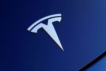 Tesla stock tumbles after reaching historic highs
