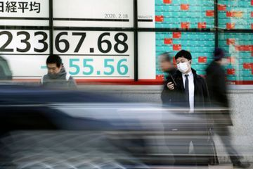Shares fall in Asia as virus outbreak hits profits, events