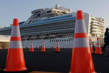 Quarantine on cruise ship in Japan comes under question