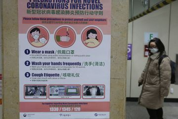 S. Korea reports 1st virus death; 2.5M urged to stay home